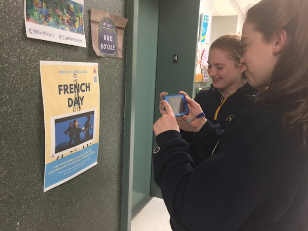 Students used virtually reality app called Aurasma to watch posters come to life during French day.
